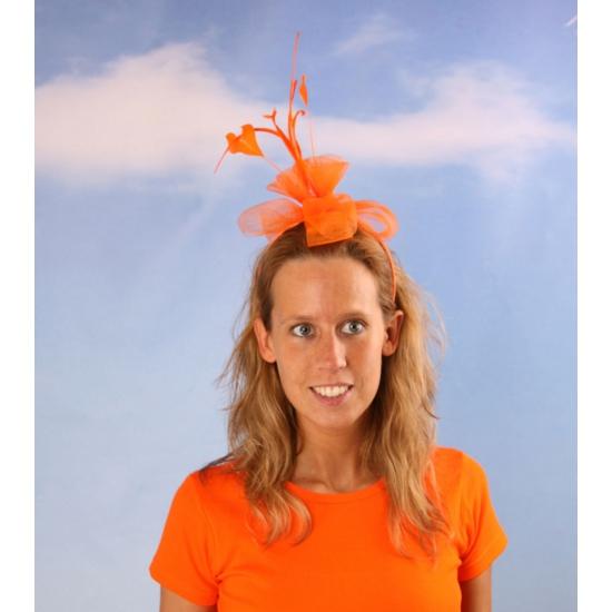 Oranje bloem op haarband