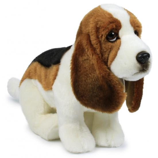 Zittende Basset hond knuffeldier