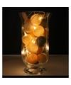 Sfeerverlichting witte gouden en antracieten balletjes in vaas